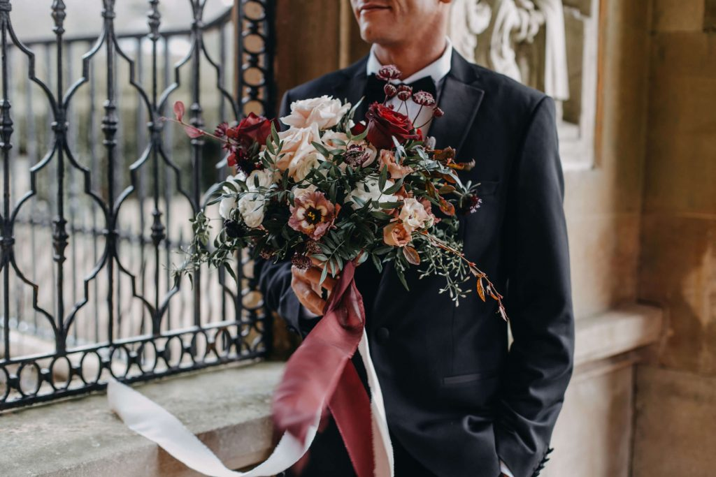waiting groom with Surrey wedding flower bouquet