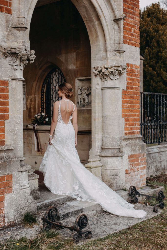 Surrey wedding venue bride in arch